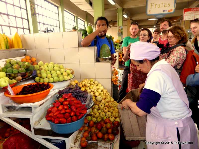Local Fruit and Vegetable Vendor at Quito Market