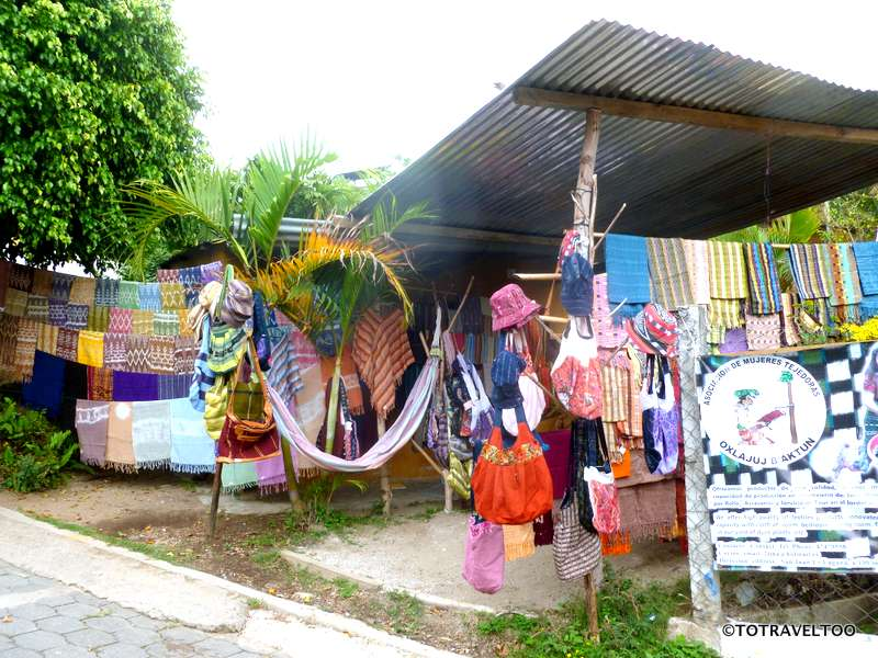 Craft shops line the street from the wharf along Lake Atitlan
