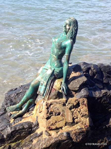 Mermaid sunning herself along Fishermans Walk in Zihuatanejo