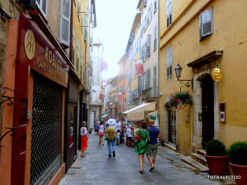 The Streets of Grasse the mist is perfume being sprayed over pedestrians