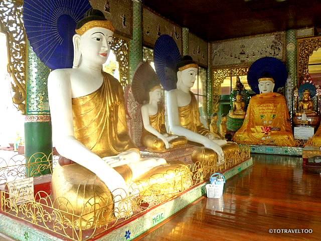 Inside the many pagodas that surround Shewedagon Pagoda